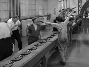 "The assembly line, in Chaplin's satyric movie ""Modern Times"""