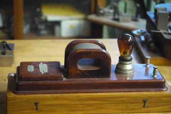 A Boettger and Wittig Demagnetizer, a watch was placed inside of the core and the slide was then moved in and out to change the polarity of the magnet, as described in patent number 699863:  The slide and comb thereon constitute a pole changer, and in practice the same is actuated to cause frequent reverses of the direction of current that goes through the electromagnet. A magnetized watch, tool, or other device is placed in the hollow core of the electromagnet… the pole changer is operated to effect its function… the result being demagnetization of said device.